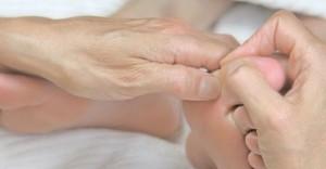 pressing the big toe